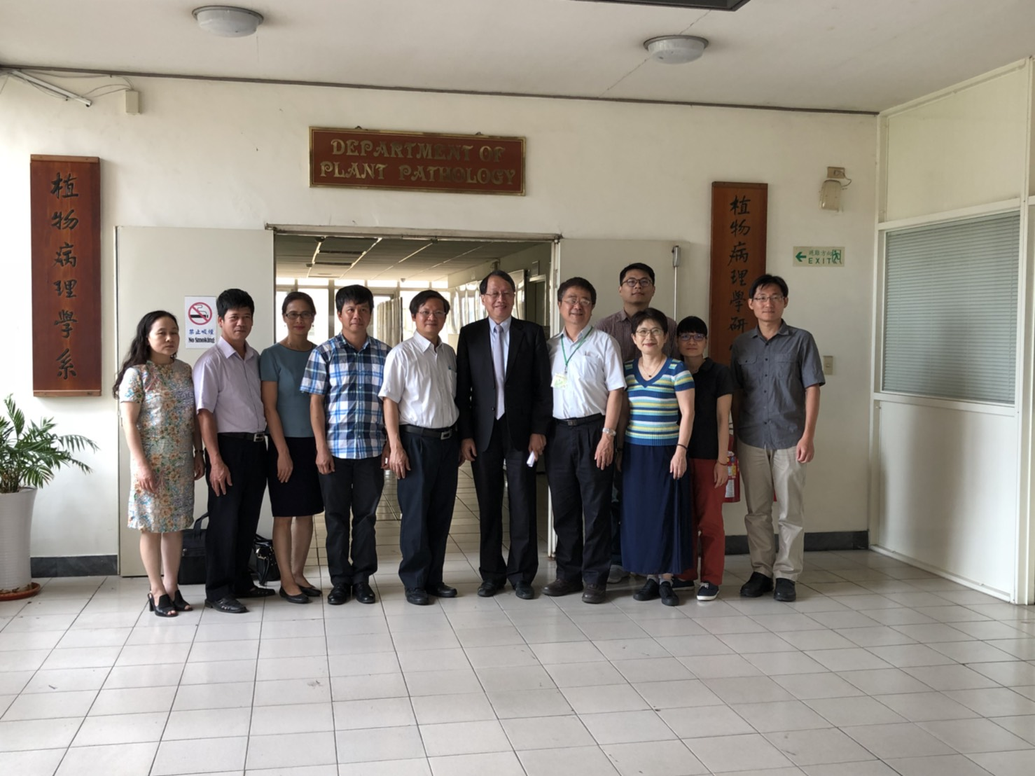 Photo taken with professors and students of NCHU Plant Pathology Department