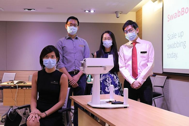 Singapore-made COVID-19 swab test robot could reduce healthcare workers' risk of infection's picture